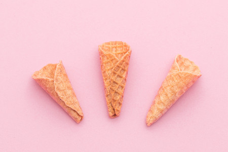 Empty wafer cone on pink background