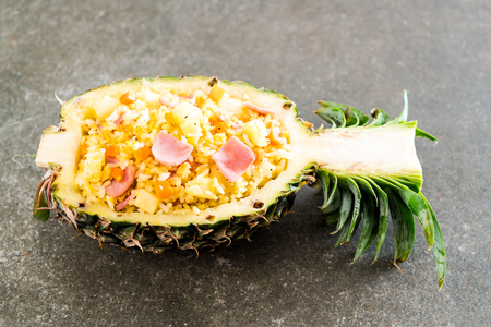 pineapple fried rice with ham on the table Stock Photo