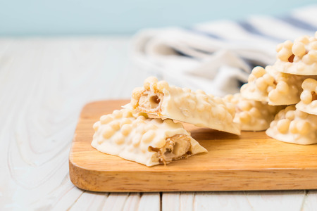white chocolate with caramel and cereal crispy bar on wood Stock Photo