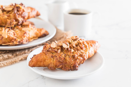 Fresh baked croissant with almonds