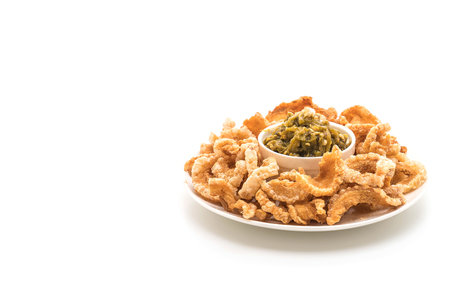 Fried pork rince or Pork snack with Nam Prik Num (Northern Thai Green Chilli Dip) isolated on white background Stock Photo