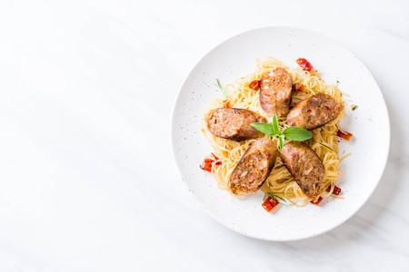 Stir-Fried Spaghetti with Sai Aua (Notrhern Thai Spicy Sausage) - Fusion food style Stock Photo