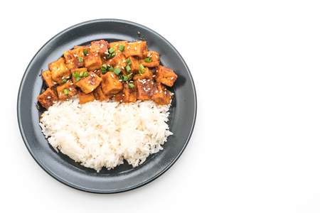 stir fried tofu with spicy sauce on rice isolated on white background Stock fotó - 95470459