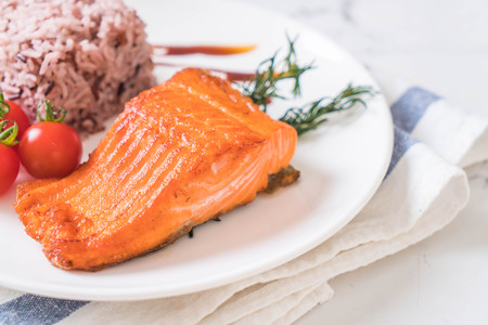 Salmon Steak with Berry Rice on plate