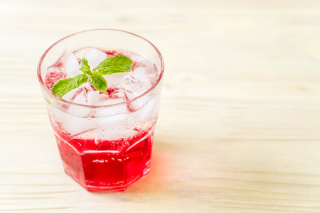 iced strawberry soda on wood table Stock Photo