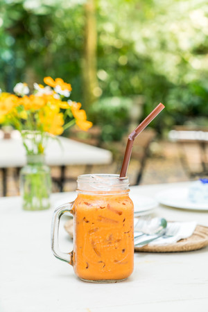 iced thai milk tea jar in restaurant or coffee shop cafe