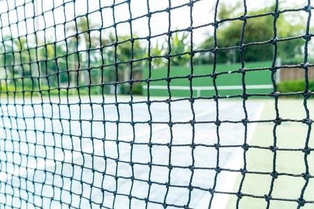 tennis net with empty tennis court background Stock Photo