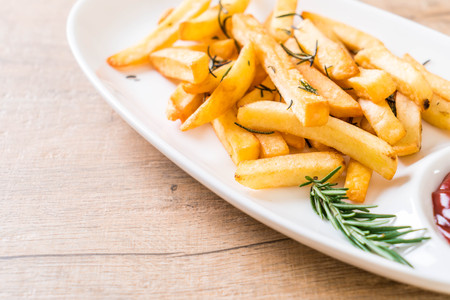 french fries with sauce - unhealthy food Stock Photo