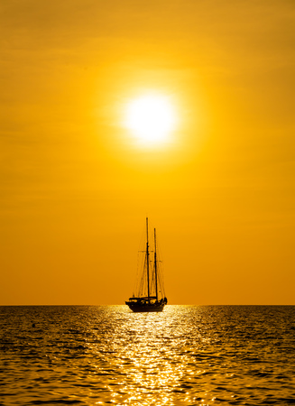 silhouette boat in sea and ocean with beautiful sunset sky - filter effect processing style