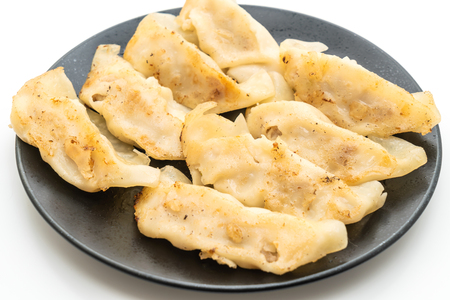 Japanese gyoza or dumplings snack with soy sauce - isolated on white background