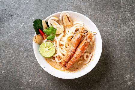 spicy shrimps udon ramen noodle (Tom Yum Goong) - japanese fusion food style Stock Photo