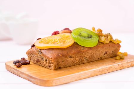 fruit cake on wood background
