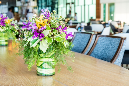 flowers in vase decoration on dinning table