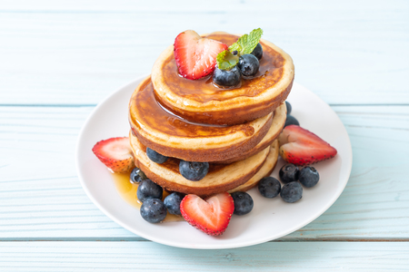 souffle pancake with fresh blueberries, fresh strawberries and honey