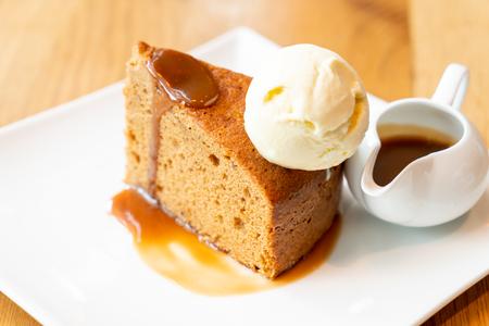 cake with vanilla ice-cream and toffee caramel sauce - british style