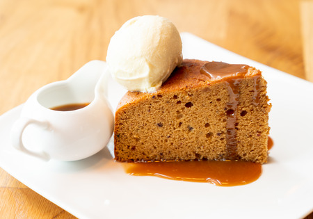 cake with vanilla ice-cream and toffee caramel sauce - british style