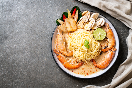 spicy shrimps spaghetti pasta (Tom Yum Goong) - Italian fusion food style Stock Photo