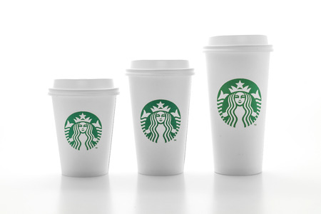 BANGKOK, THAILAND - JUN 5, 2018: White coffee cup with Starbucks logo isolated on white background. Starbucks is the worlds largest coffee house with over 20,000 stores in 61 countries. Editorial
