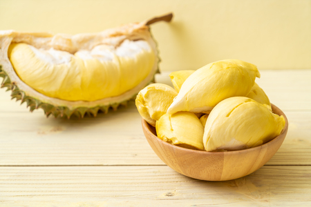 Fresh Durian Fruit on wood background