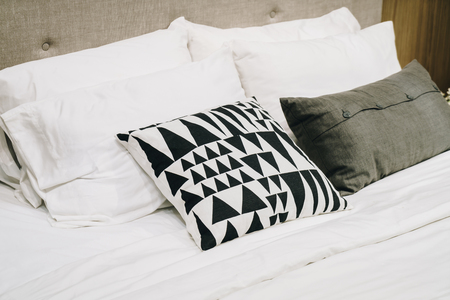 beautiful and comfortable pillow decoration on bed - vintage effect filter Reklamní fotografie