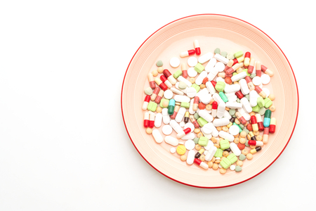 pills ,drugs ,pharmacy ,medicine or medical on plate isolated on white background