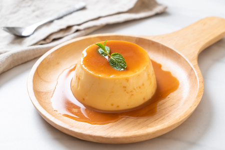 homemade caramel custard pudding with mint Foto de archivo