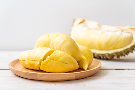 Fresh Durian Fruit on wood background 写真素材 - 104279612