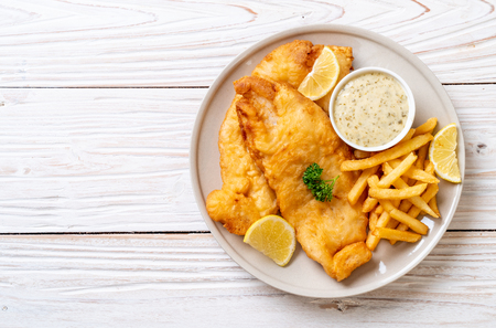 fish and chips with french fries - unhealthy food Standard-Bild
