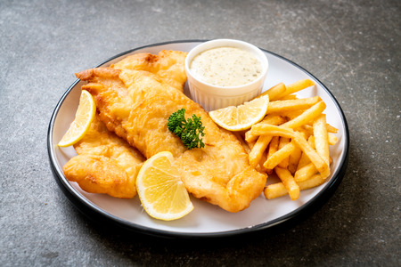 fish and chips with french fries - unhealthy food Stockfoto