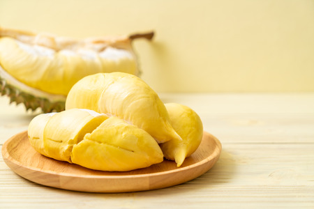 Fresh Durian Fruit on wood background Stock Photo - 104894393