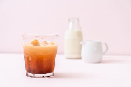 Thai tea ice cube with milk on wood background
