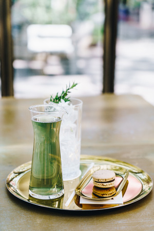 iced green tea with macaroon Stock Photo