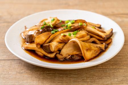 stir-fried king oyster mushroom in oyster sauce - healthy, vegan or vegetarian food style