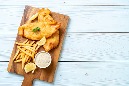 fish and chips with french fries - unhealthy food Stock Photo