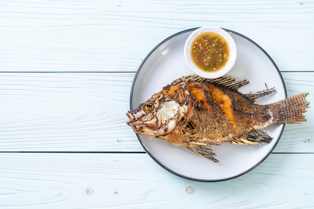 deep fried fish with spicy seafood sauce