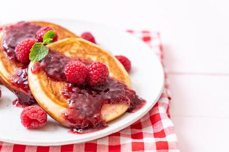 souffle pancake with fresh raspberries and raspberry sauce