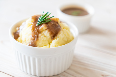 homemade mashed potatoes with gravy sauce Foto de archivo