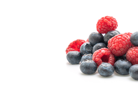 fresh raspberries and fresh blueberries isolated on white background