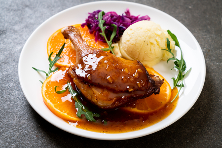 roasted duck leg steak with orange sauce Фото со стока