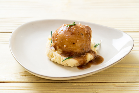 homemade mashed potatoes with gravy sauce Stock Photo