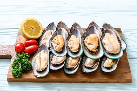 fresh mussel on wood board with ingredients Stock fotó