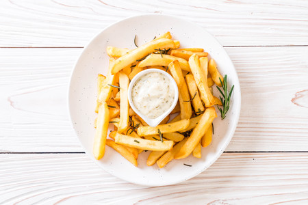french fries with sauce - unhealthy food Archivio Fotografico