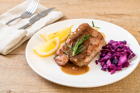 pork steak with red cabbage and mashed potatoes on white plate 스톡 콘텐츠