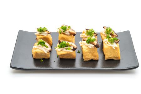 Grilled Tofu with Shitake Mushroom and Golden Needle Mushroom isolated on white background
