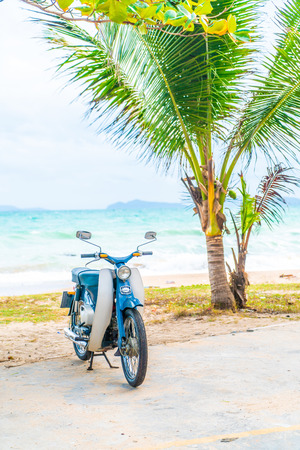 Old and classic bike with sea background - vacation concept Stock Photo