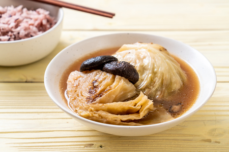 boiled cabbage in red soup with mushroom - vegan and vegetarian food in Asian style
