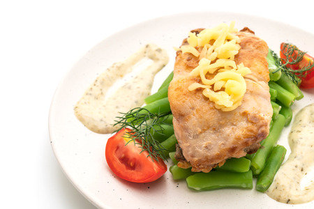 grilled snapper fish steak with vagetable isolated on white background