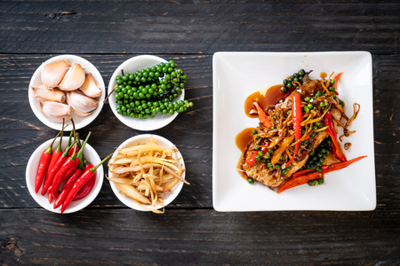 stir-fried spicy and herb with grouper fish fillet  - Thai food style Archivio Fotografico