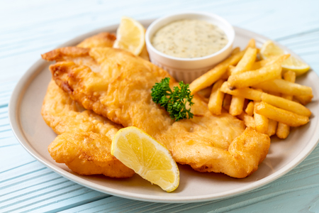 fish and chips with french fries - unhealthy food 免版税图像