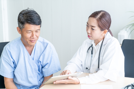 Asian Senior Patient Having Consultation With Doctor in Office  - selective focus point 免版税图像 - 110308817